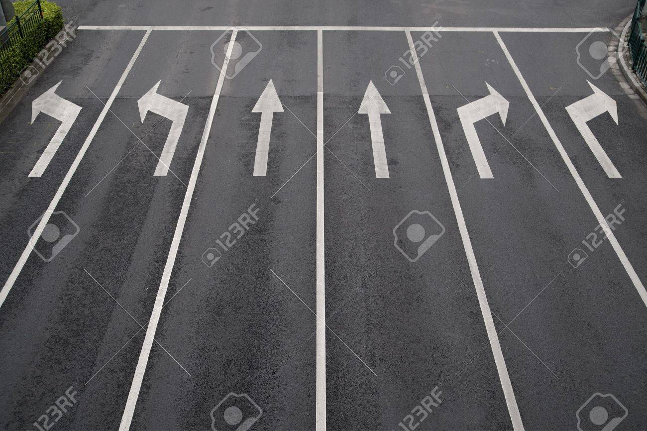 Arrow signs as road markings on a street with six lanes Stock Photo - 8175565