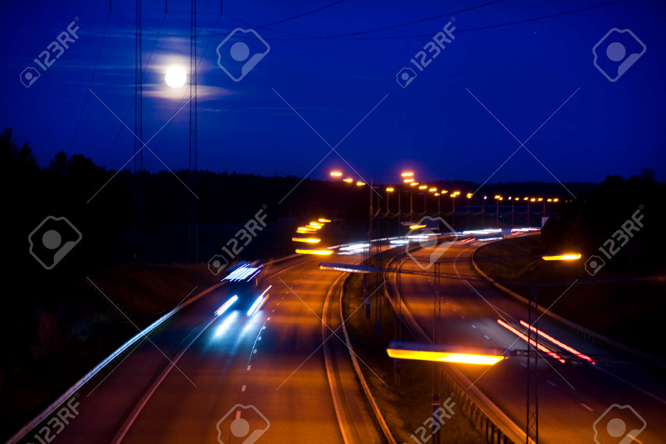 Highway in bright moonshine and a dark blue sky Stock Photo - 8311585