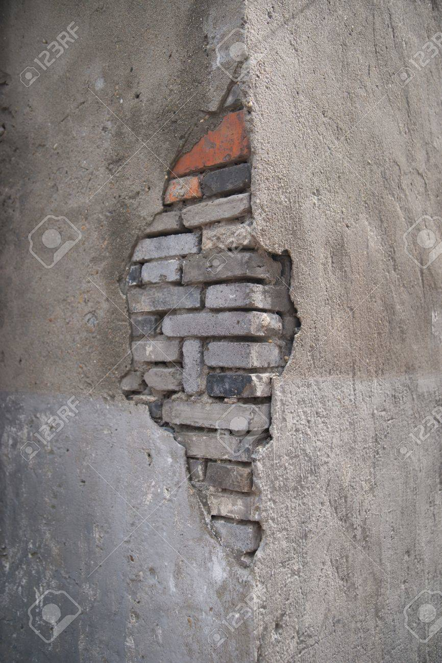 concrete wall with hole with visible bricks Stock Photo - 8455174