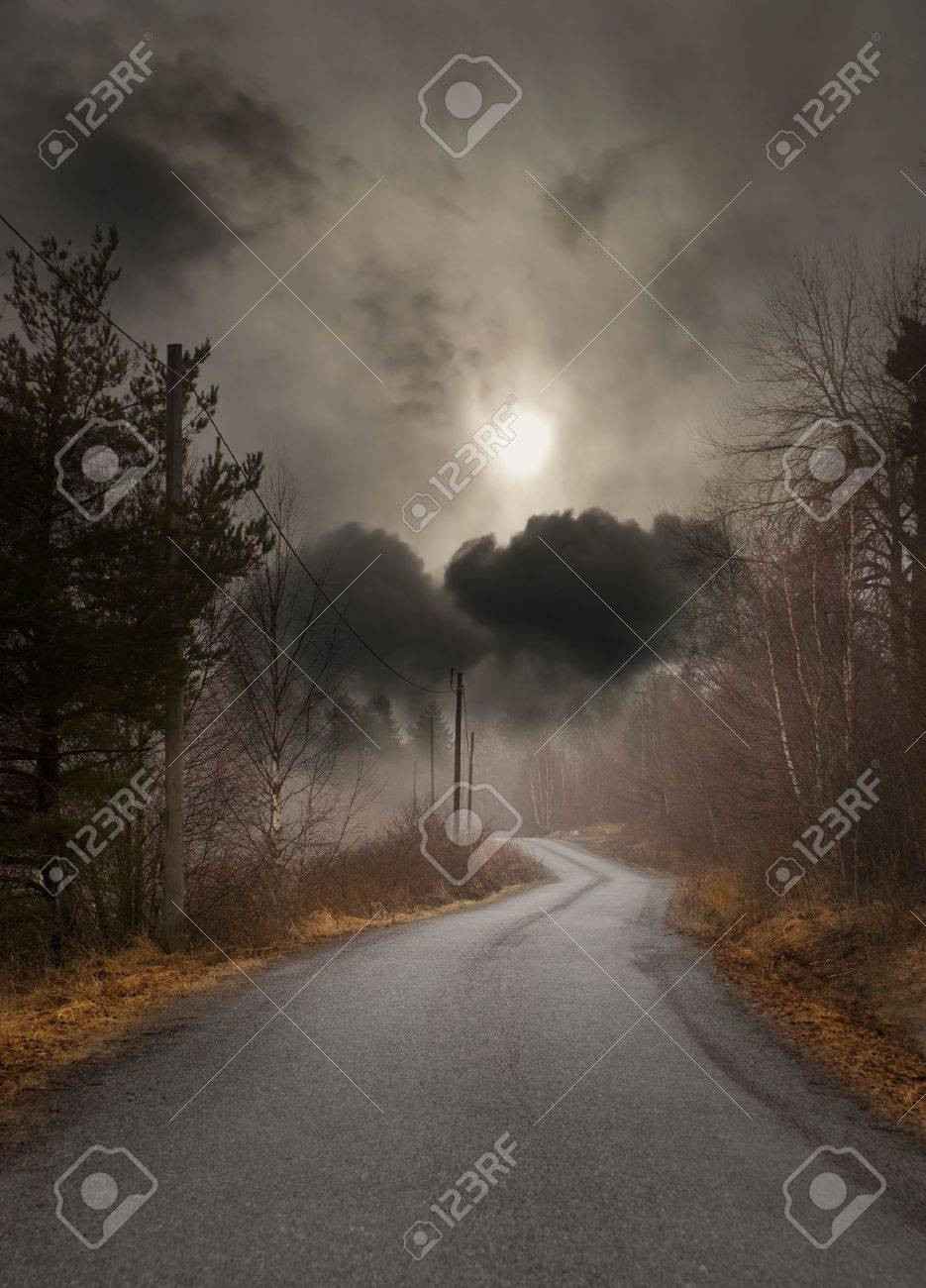 Narrow country road on gloomy autumn day Stock Photo - 9496069