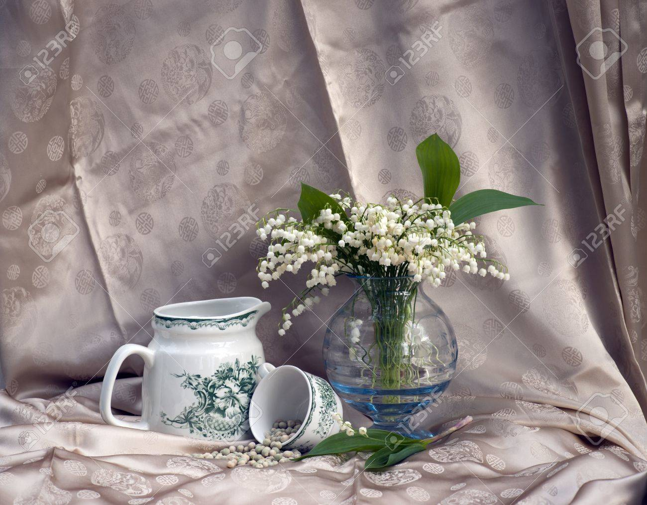 Still life with lily-of-the-valley flowers in a vase Stock Photo - 9658137