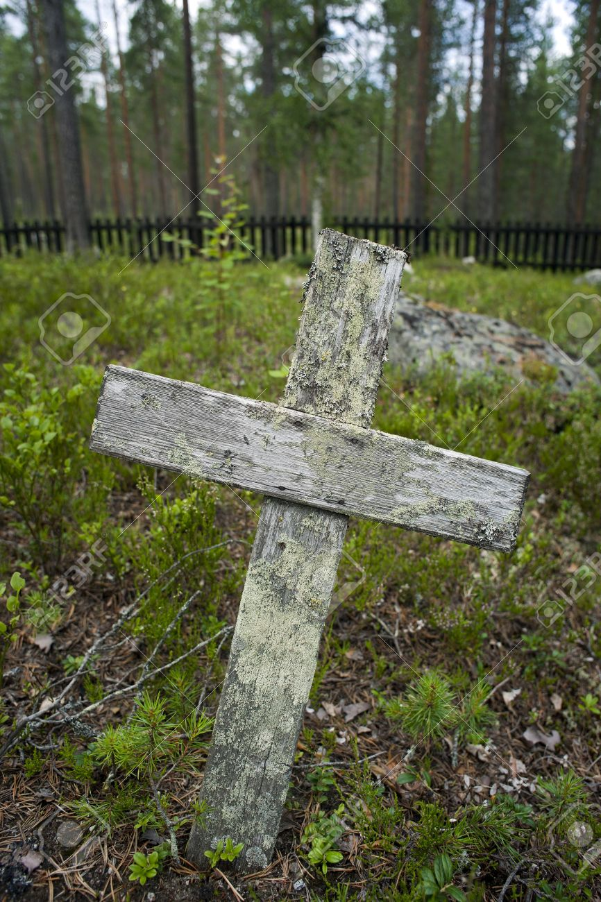 Wooden Cross On Old Grave Yard