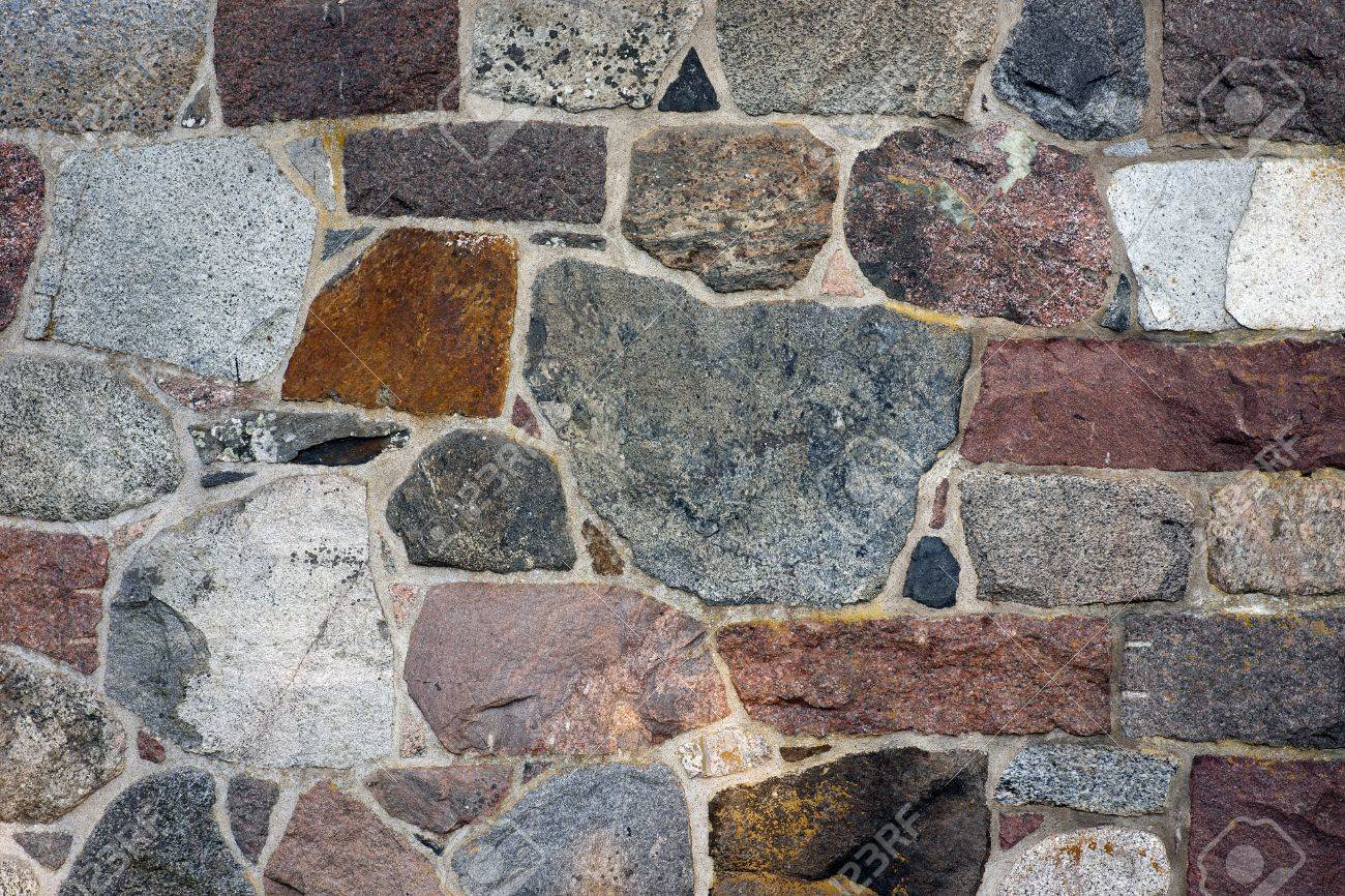 Wall Of Naural Granite Rock In Different Colors Stock Photo Picture