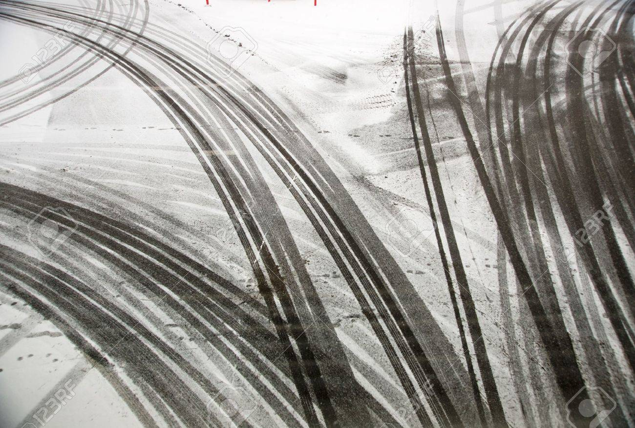 tire tracks on asphalt in snow Stock Photo - 11083831