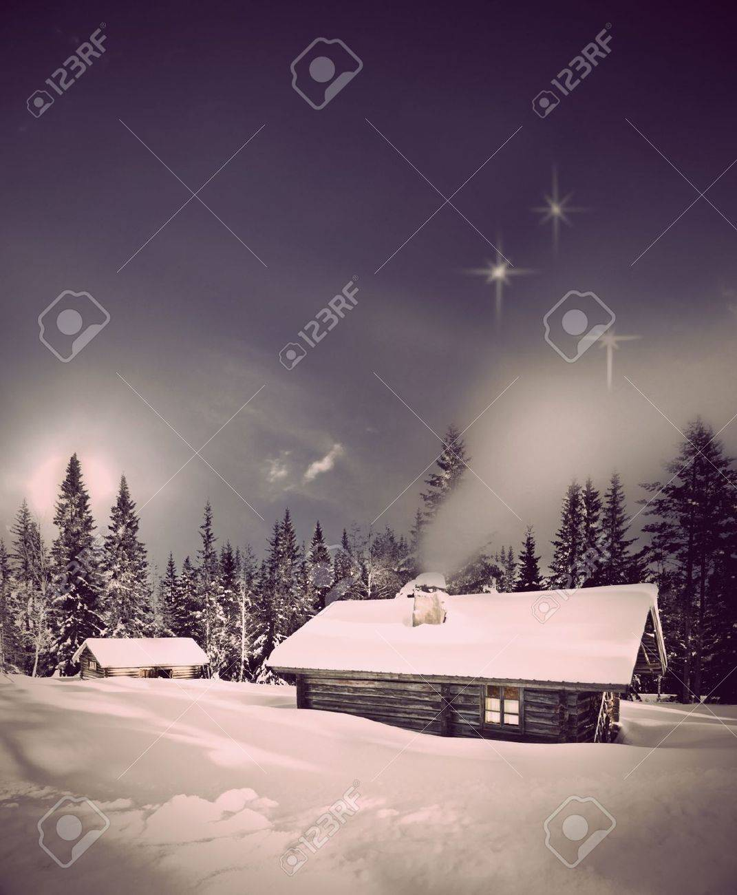 Remote log cabin in winter evening with stars in sky - 11888459