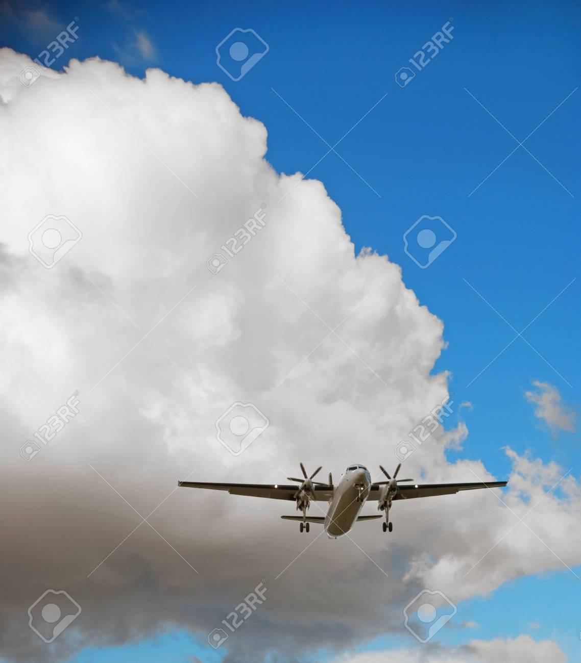 Propeller passenger aircraft taking off on blue sky Stock Photo - 12441167