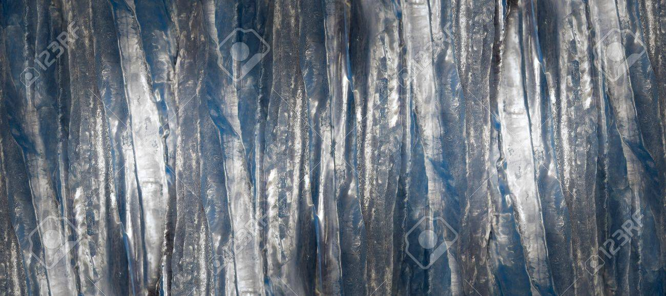 Stock Photo - Wallpaper of icicles in shades of blue