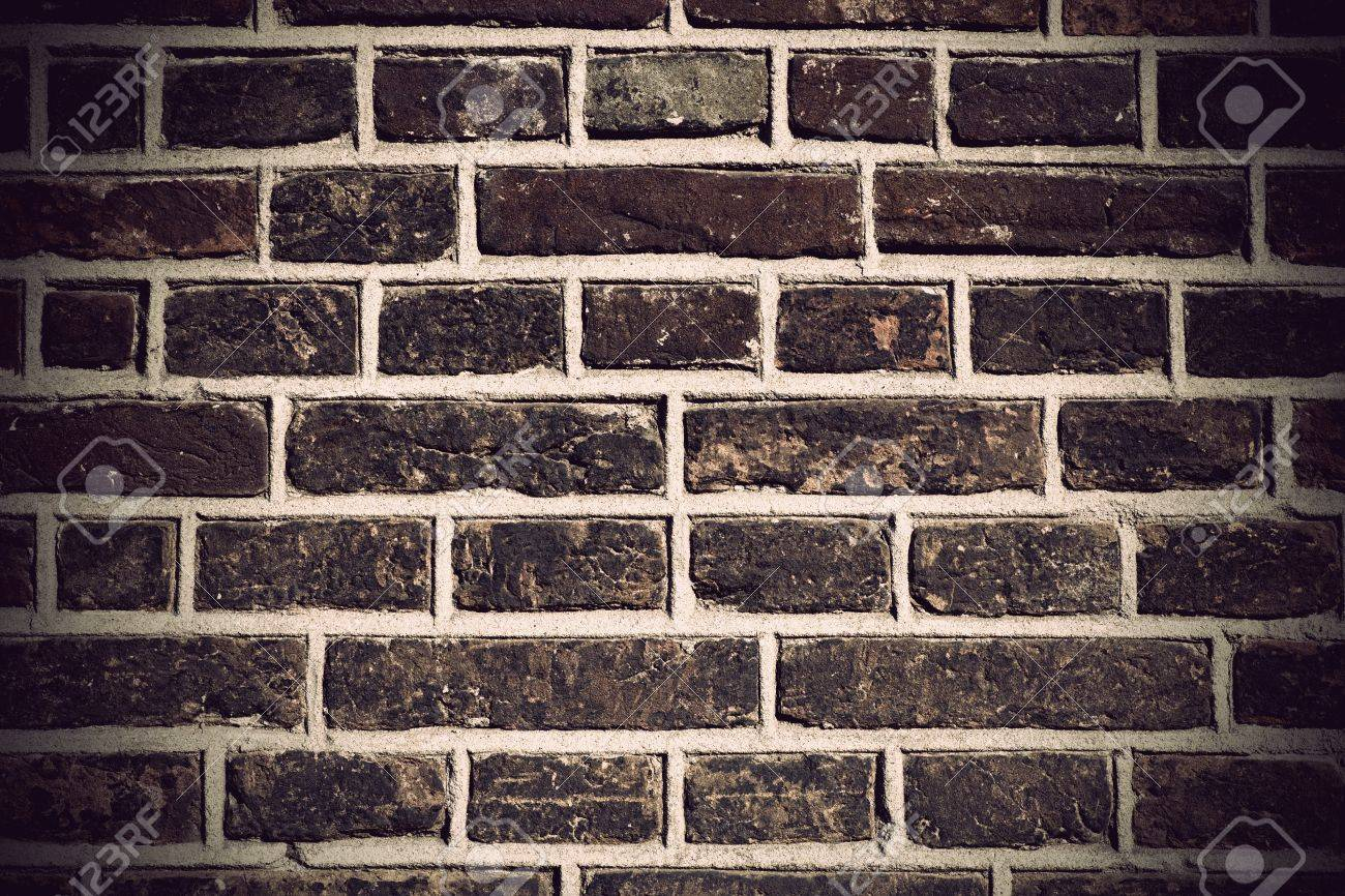 Grunge old brick wall in dark colors Stock Photo - 13007981