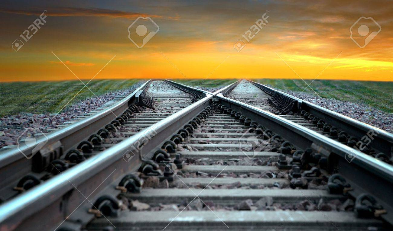 Landscape with railroad disappearing into sunset - 15039929