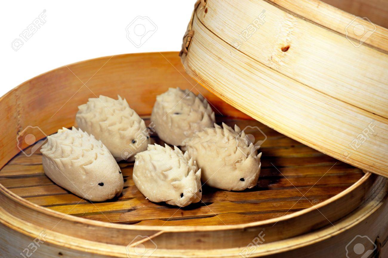 archivio fotografico creativa cucina cinese con ravioli al vapore a forma di maiale di copertura