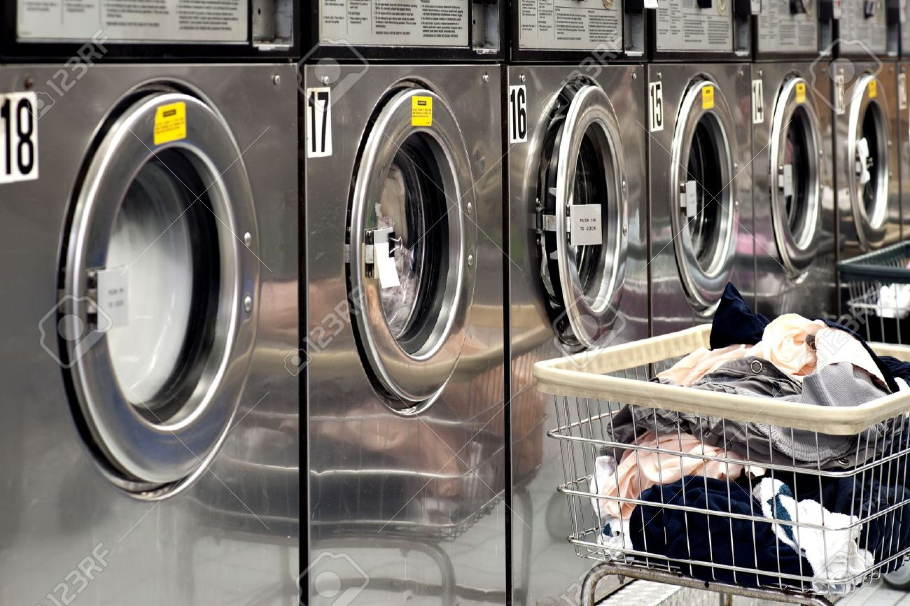 Industrial Laundry Room Part - 46: Row Of Industrial Washing Machines In A Public Laundromat, With Laundry In  A Basket Stock