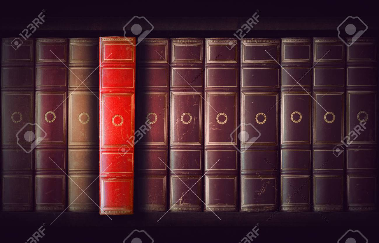 Different Shades Of Red vintage books in different shades of red and brown in bookcase