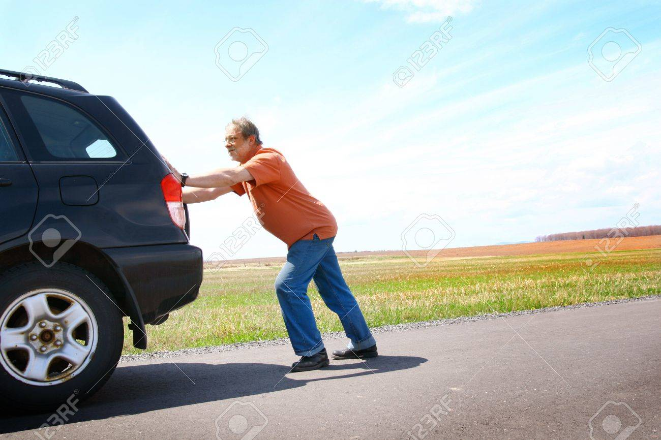 Senior man pushing his broken car Stock Photo - 9779899