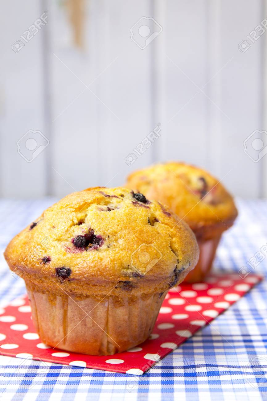 two blueberry muffins on a red dots clothes stock photo picture and