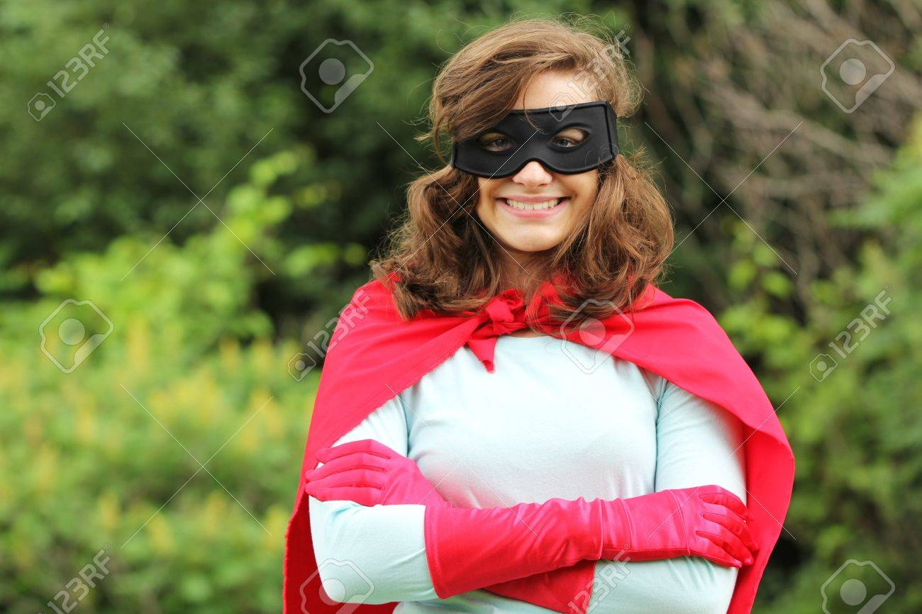 Young woman with red super heros kit smiling Stock Photo - 14656211