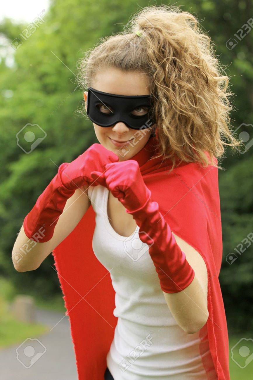 Blond masked girl ready to fight wearing a red cape and red gloves Stock Photo - 14815769