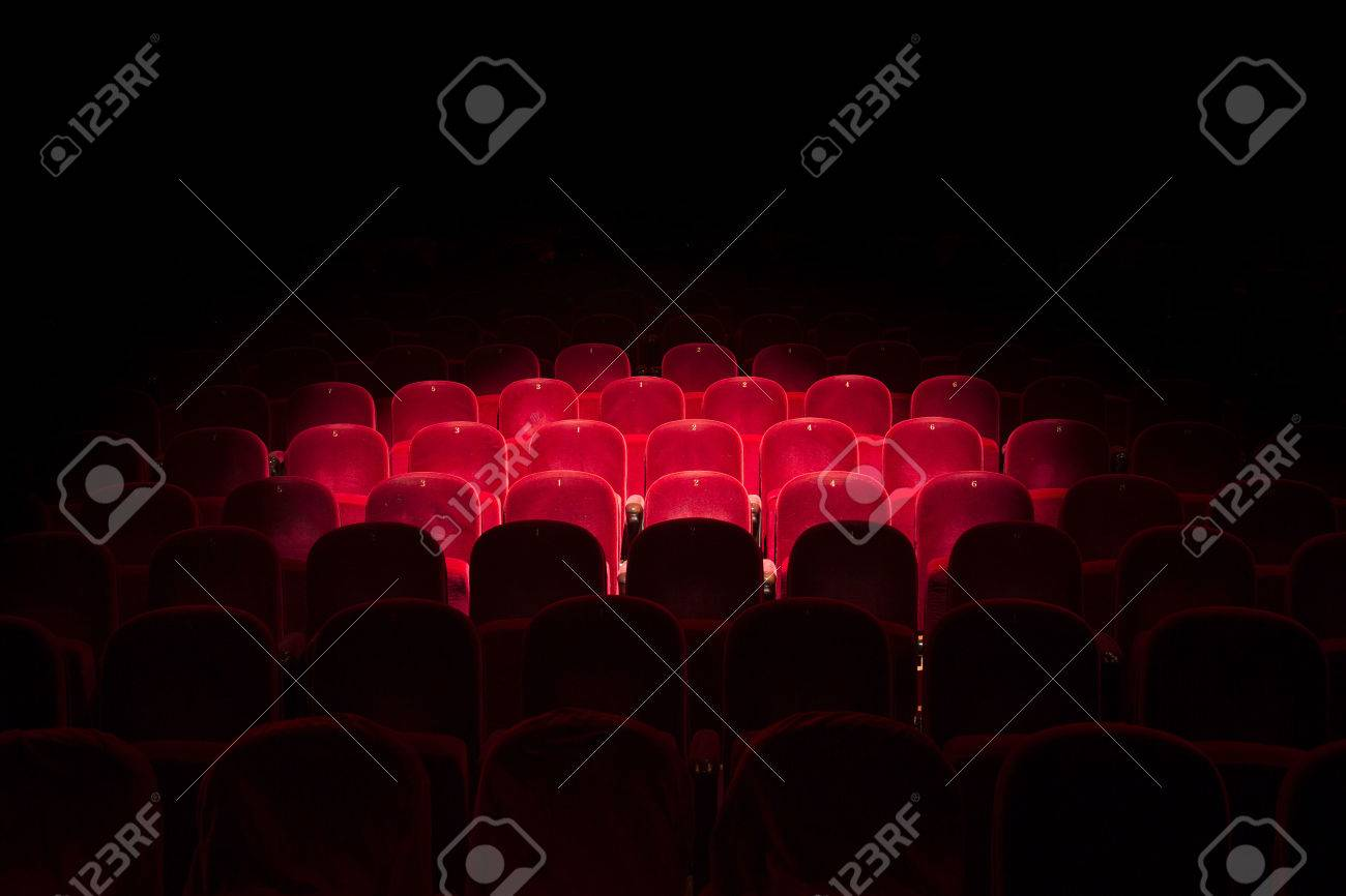 Follow spot on red seat in a generic theater - 50002583