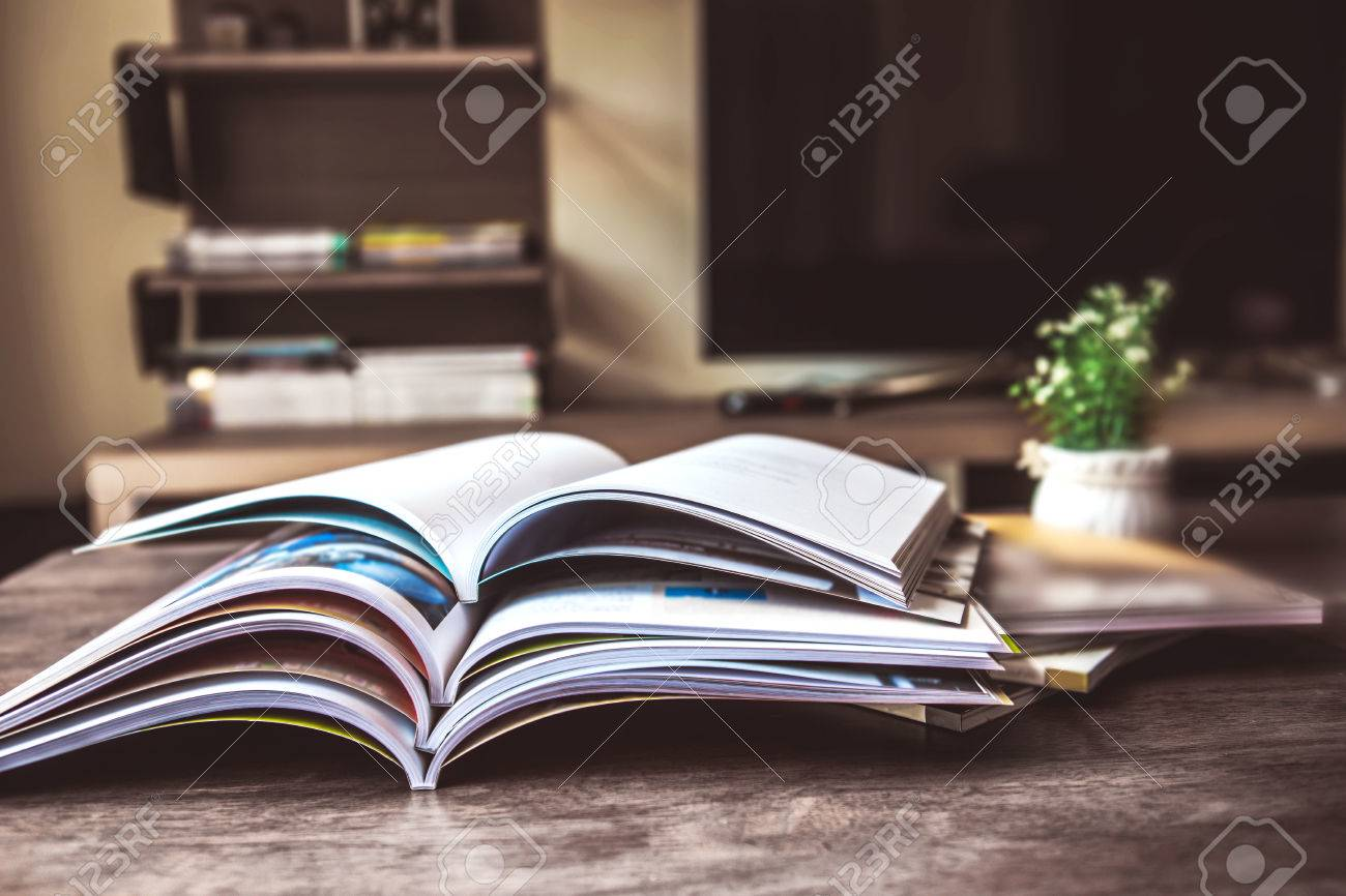 selective focus of the stacking magazine place on table in living room - 83525361
