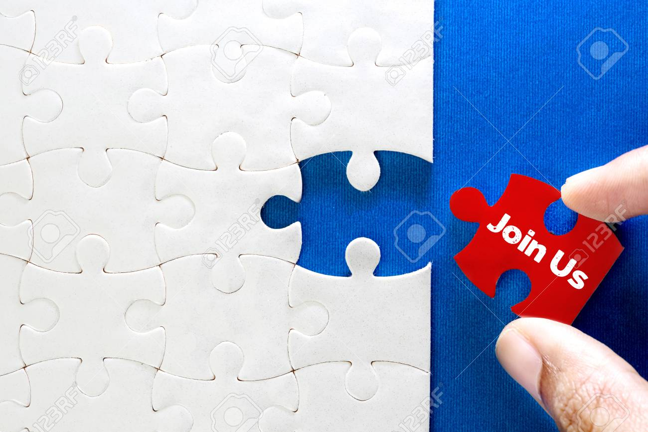 Close up piece of white jigsaw puzzle with Join Us text , concept of business challenge success completion with teamwork - 101989335