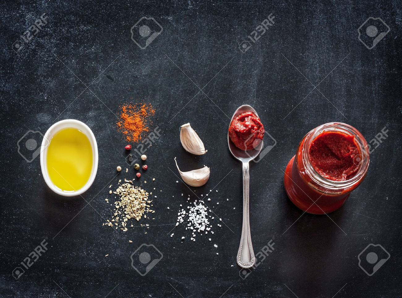 Pizza topping sauce ingredients or recipe on black background. Background with free text space. - 55317397