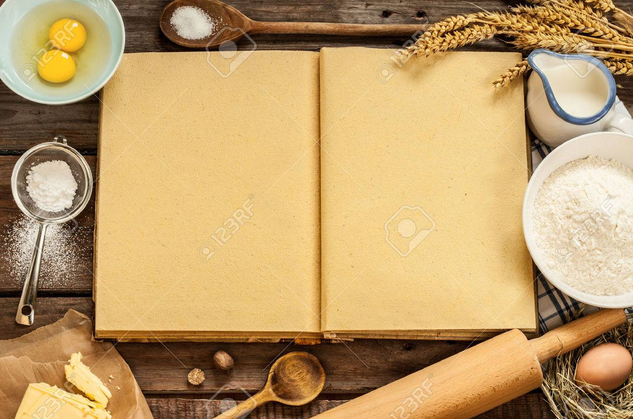 Rural vintage wood kitchen table with blank cook book, baking cake ingredients (eggs, flour, milk, butter, sugar) and cooking utensils around. - 55317489