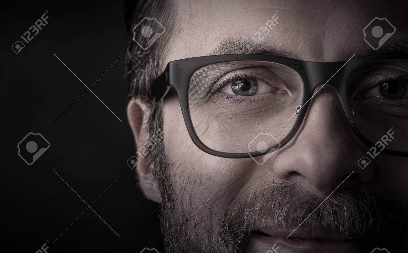 d119f1304d0e Eyes and glasses - happy smiling bearded caucasian man s face close up  (macro).