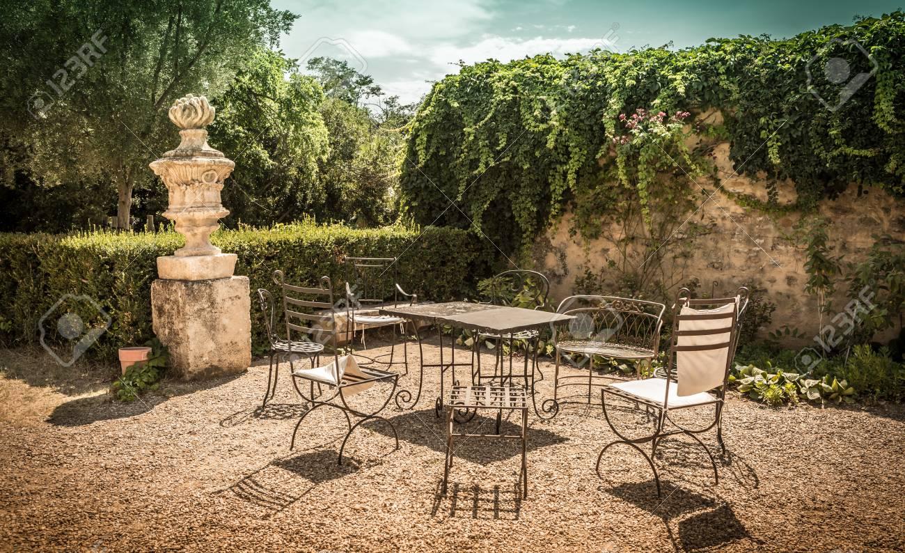 Summer Peaceful Vintage Garden Nook With Metal Furniture (table ...