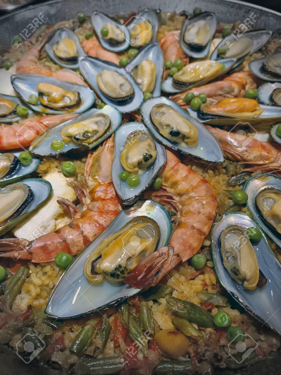 Malaga, Spain, June 2020 - Paella food mix of seefood and veggies - 152124203