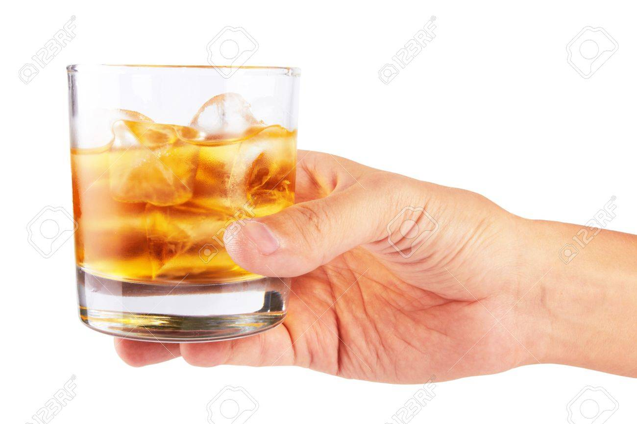 Glass of whisky in hand isolated on a white Stock Photo - 17113416