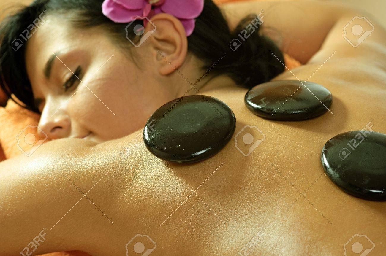 Photo of young woman using stone massage. Stock Photo - 10050132