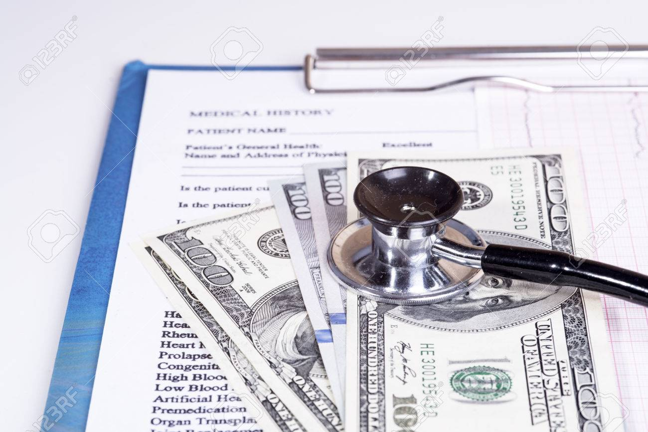medical history questionnaire and money stock photo picture and