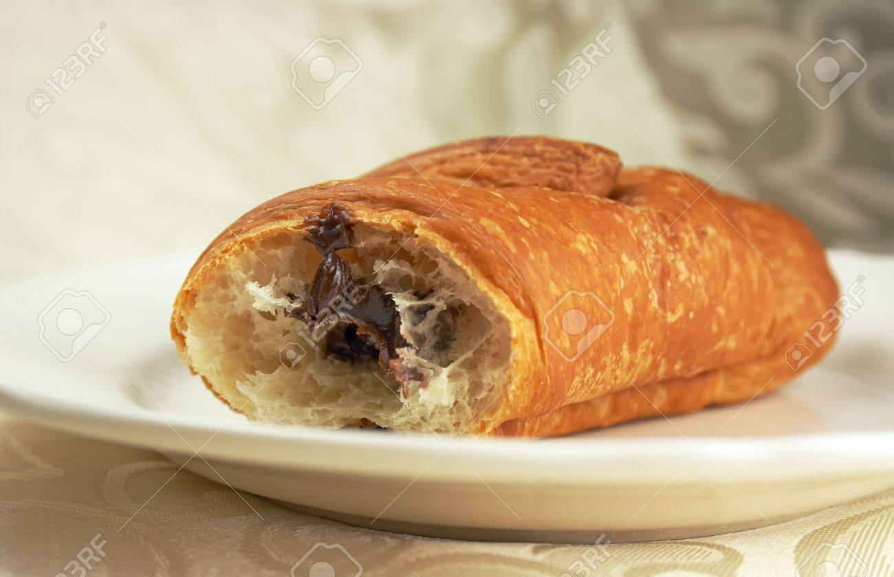 Sweet Chocolate Croissant On The Plate Stock Photo, Picture And ...