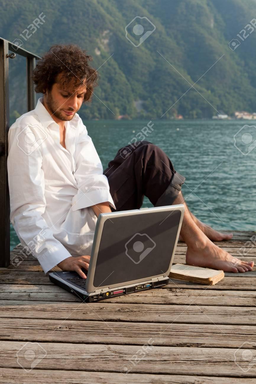 man writing on the laptop Stock Photo - 18788916