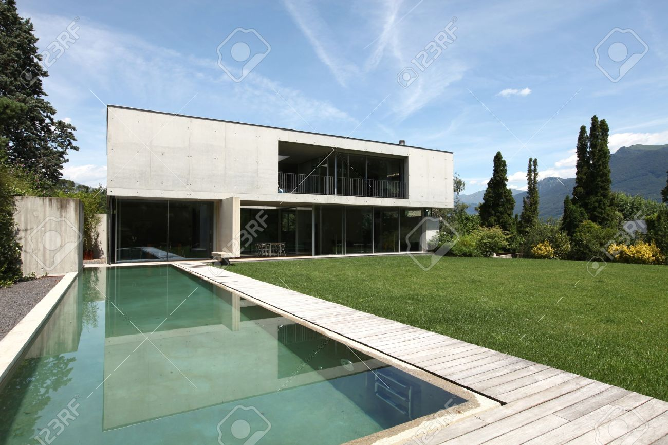 Modern house and garden - Modern House With Pool And Garden Stock Photo 21011994