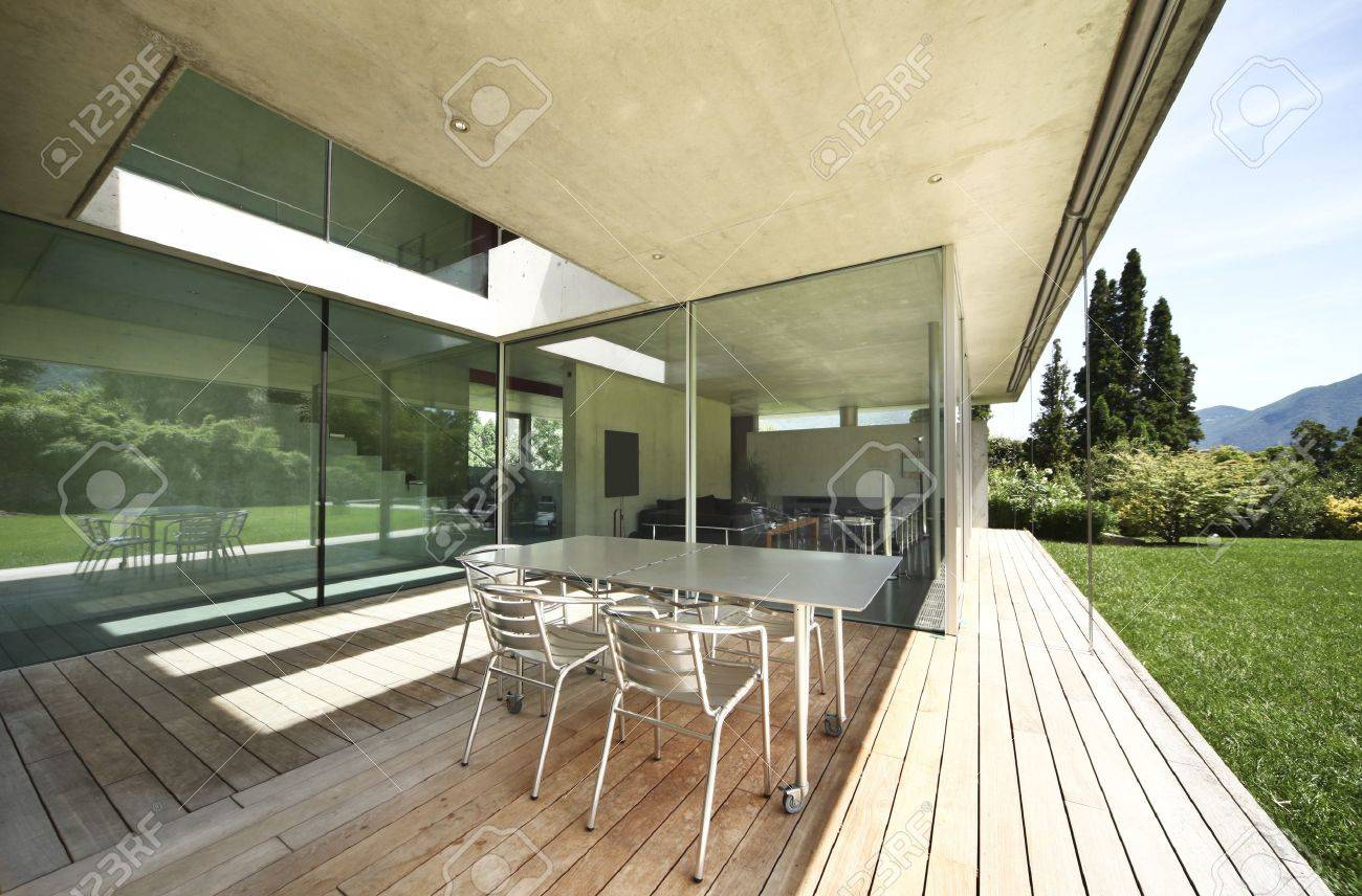 Stock photo table and chairs on the veranda modern house