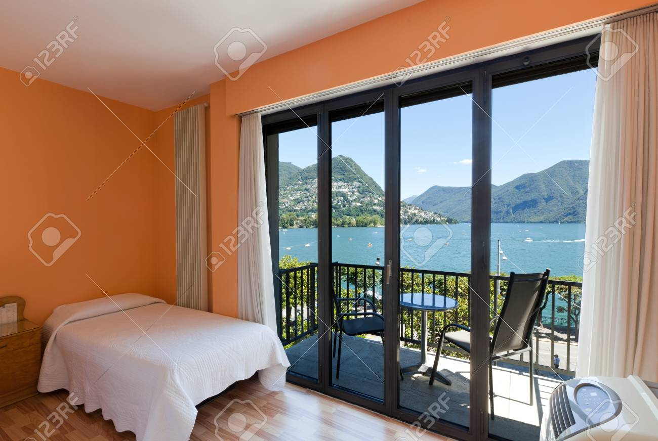 hotel room with exceptional views of the lake and mountains Stock Photo - 22549279