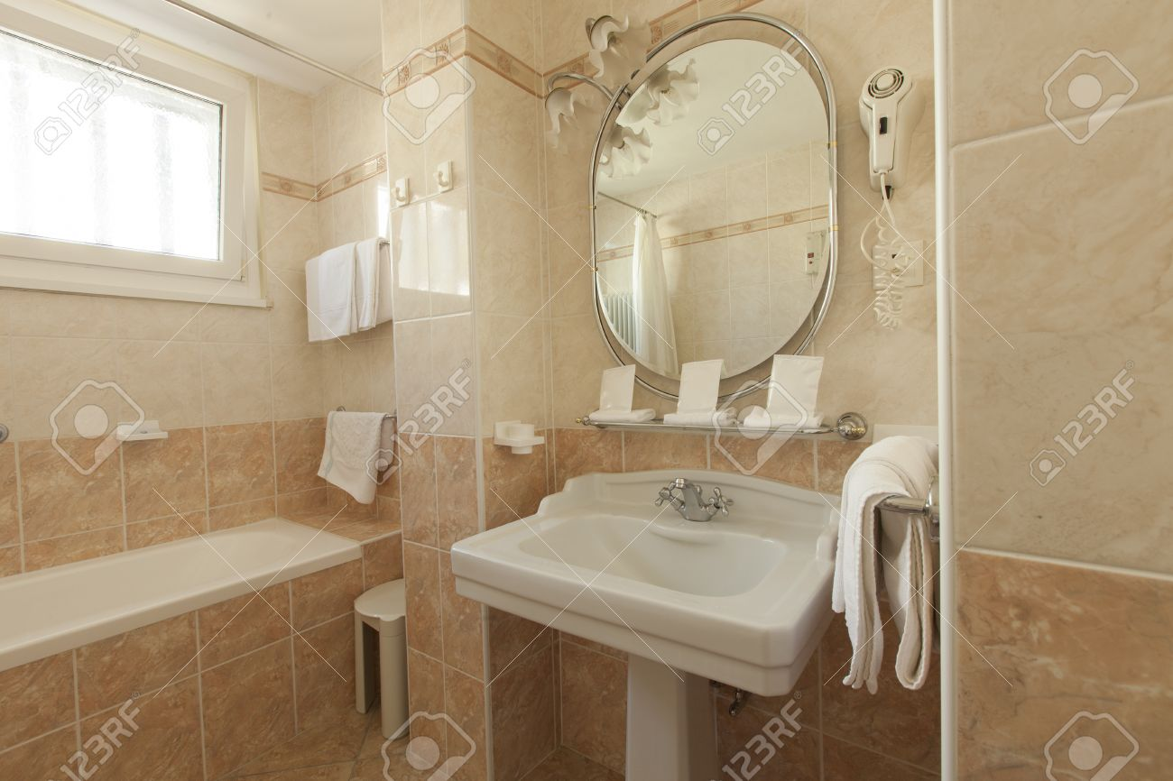 Bathroom With Beige Tiles And Decorations Stock Photo, Picture And ...