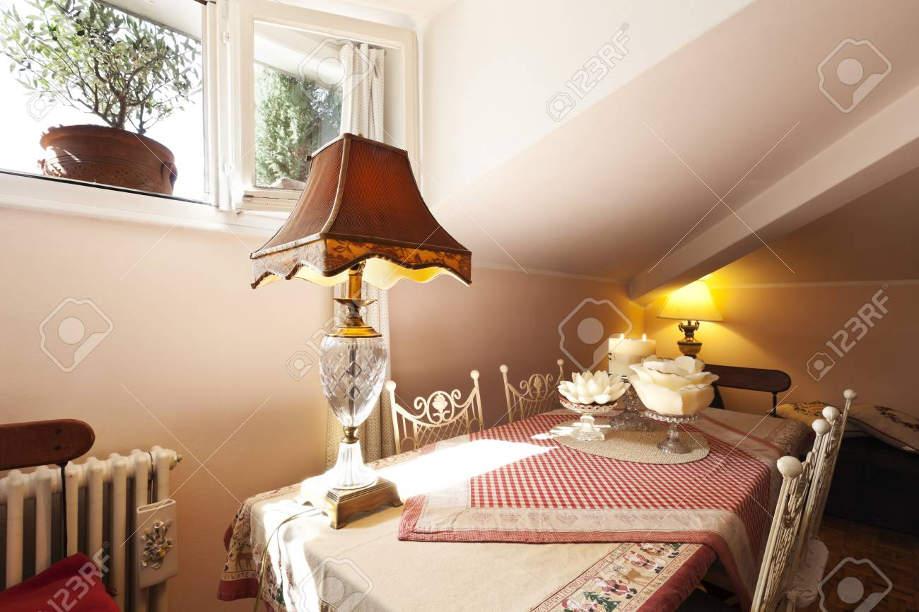 interior apartment, small loft furnished, table Stock Photo - 23448730