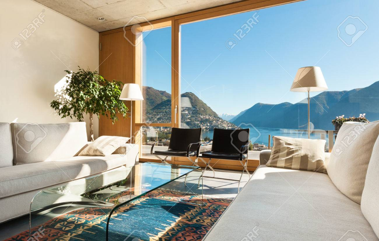 Beautiful modern house in cement interiors view from the living room stock photo