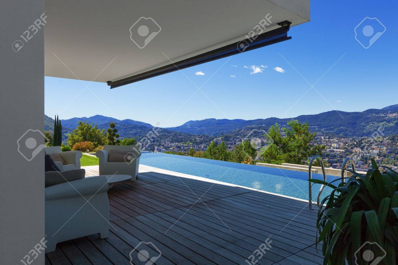 Modern House With Infinity Pool In xterior Stock Photo, Picture ... - ^