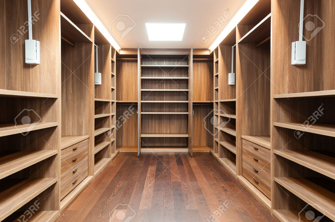 Wide wooden dressing room interior of a modern house stock photo