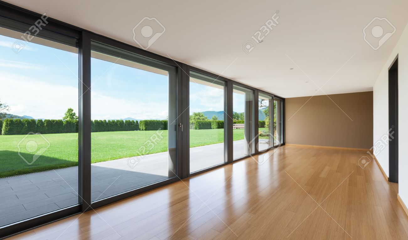 Interior modern villa, wide living room with large windows