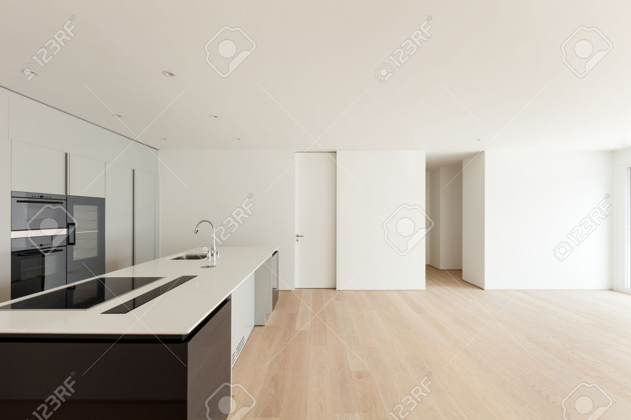 Beautiful Empty Apartment With Hardwood Floor Modern Kitchen Stock Photo