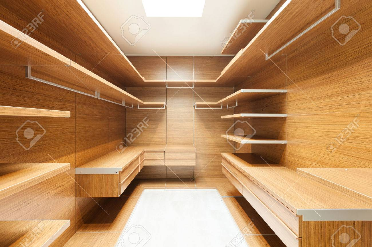 wide wooden dressing room, interior of a modern house - 35408819