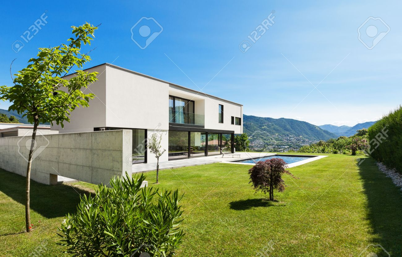 Modern house exterior modern villa with pool view from the garden stock photo