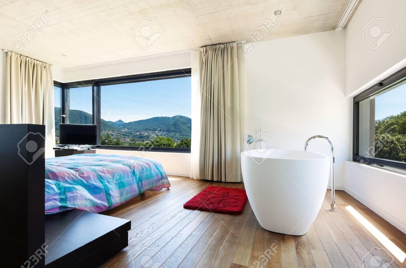 Modern Villa, Interior, Bedroom With Bathtub Stock Photo, Picture ...