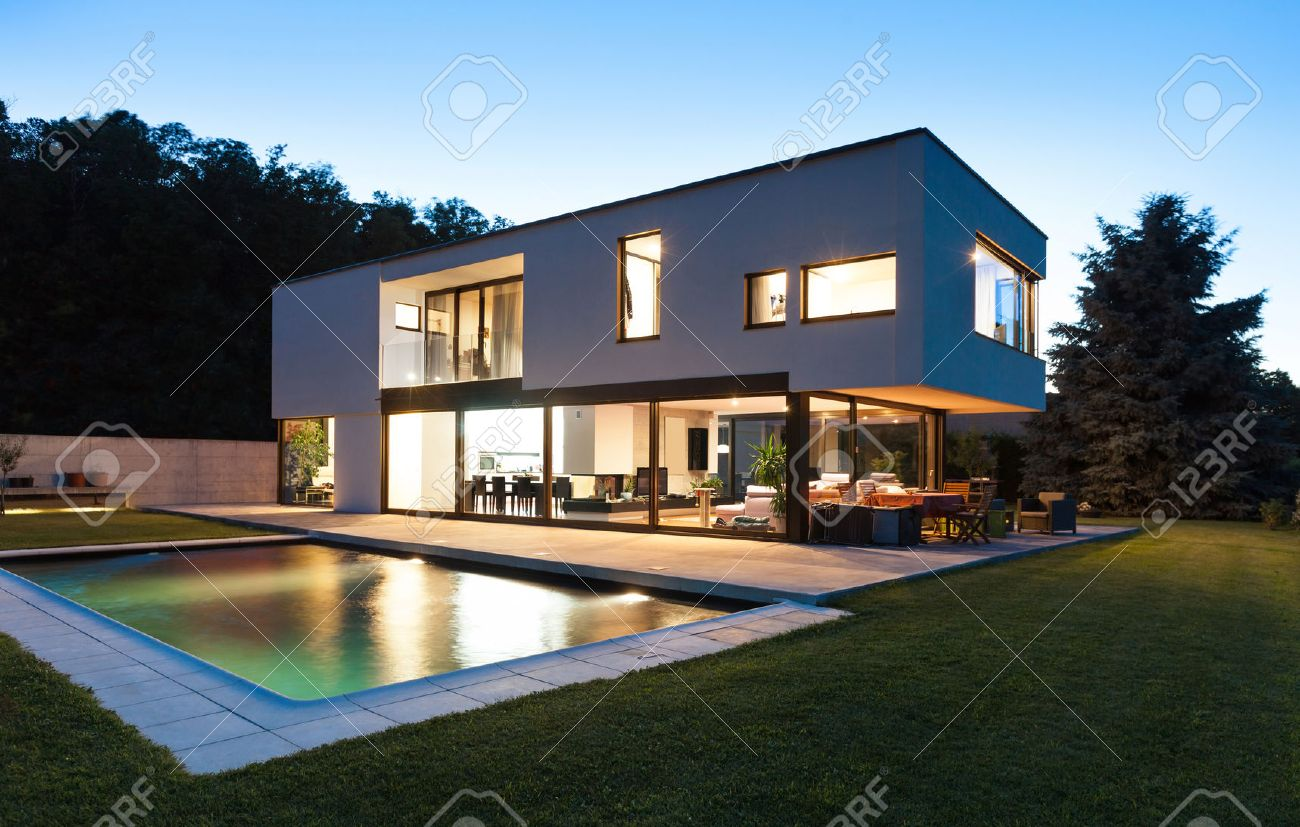 Villa Moderne modern villa with pool, night scene stock photo, picture and royalty