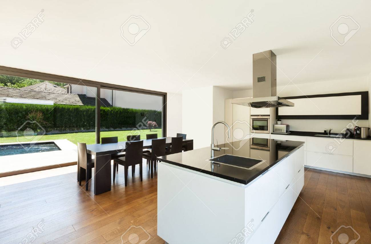 Modern Villa Interior Beautiful Kitchen And Dining Table Stock
