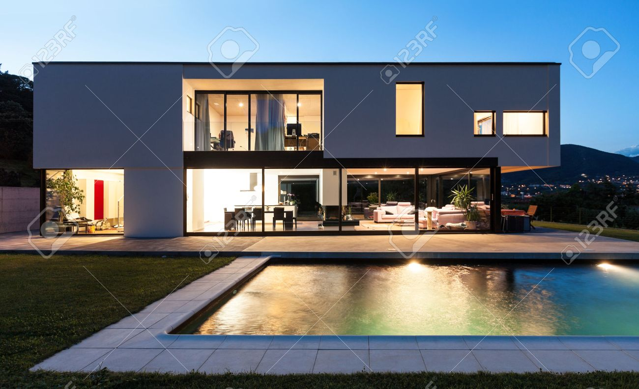 Modern villa with pool night scene stock photo picture and