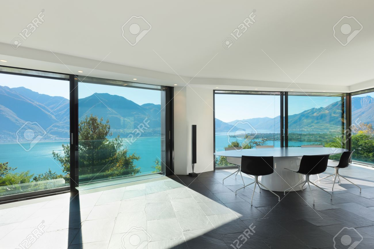 Interior of modern house wide dining room with glass walls stock photo 39039539
